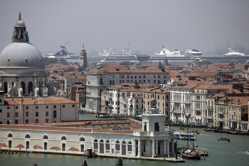 """FILE-- Cruise ships are moored at Venice's harbor in Venice, Italy, Saturday, June 8, 2019. Declaring Venice's waterways a """"national monument,"""" Italy ..."""