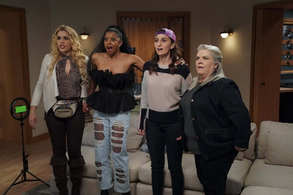 """This image released by Peacock shows Busy Philipps, from left, Renée Elise Goldsberry, Sara Bareilles and Paula Pell in """"Girls5eva."""" (Heidi Gutman/Pea..."""