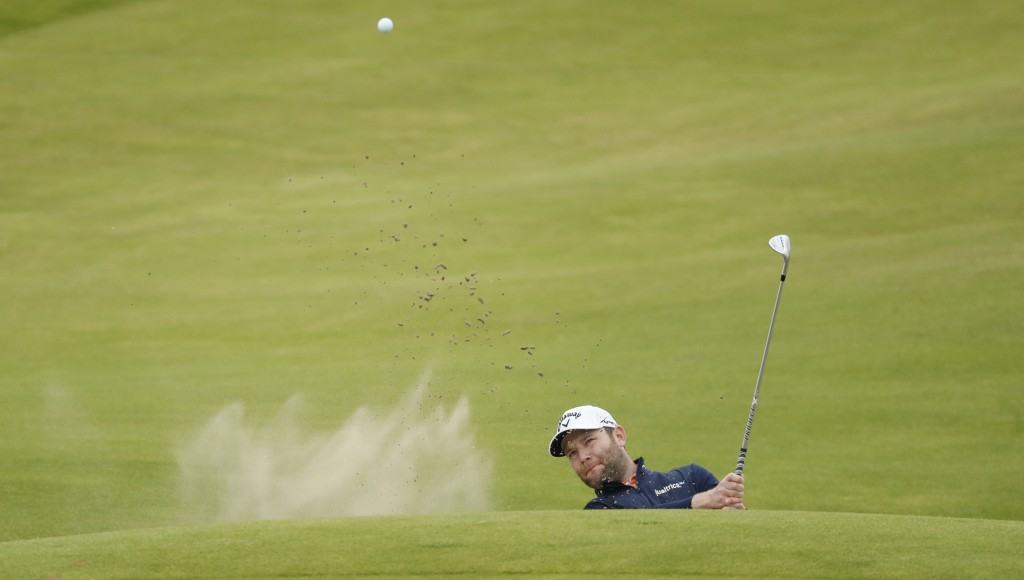 South Africa's Branden Grace plays out of a bunker on the 2nd hole during a practice round for the British Open Golf Championship at Royal St George's...