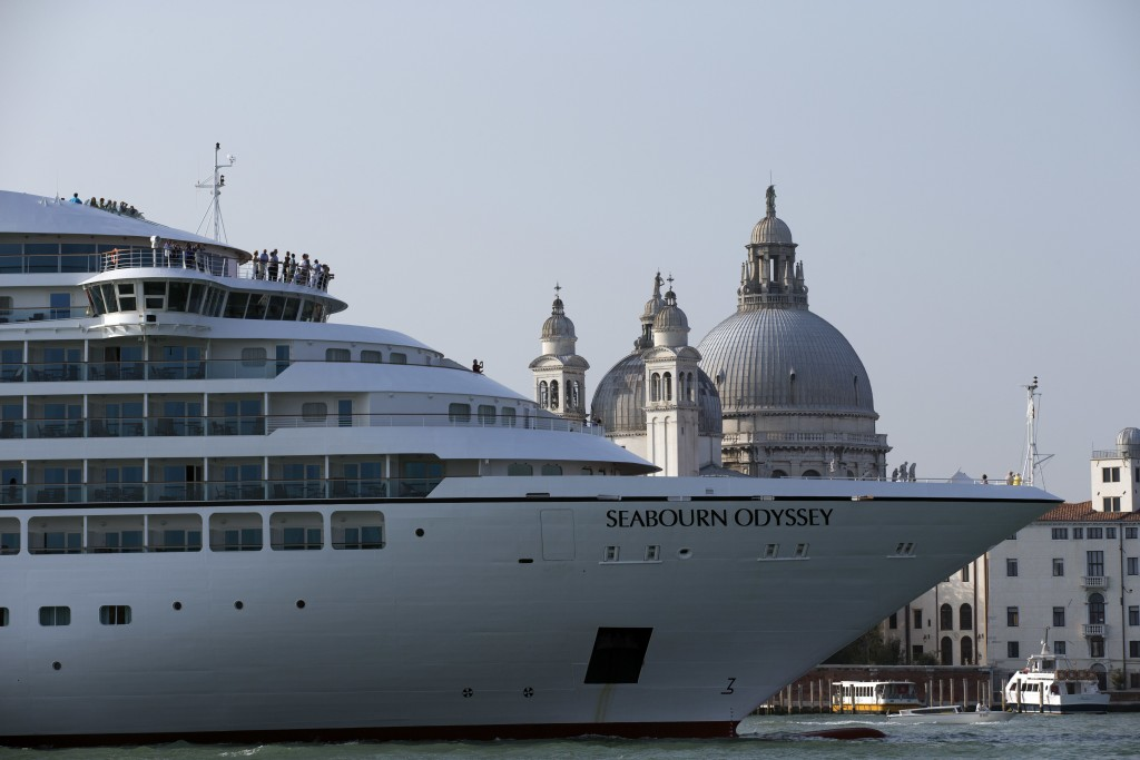 FILE--  In this Sept. 27, 2014 file photo a cruise ship transits in the Giudecca canal in front of St. Mark's Square, in Venice, Italy. Declaring Veni...