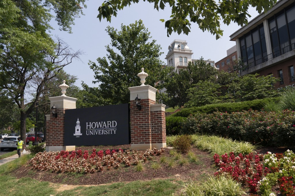 FILE - In this July 6, 2021, file photo, an electronic signboard welcomes people to the Howard University campus in Washington. Two high-profile facul...