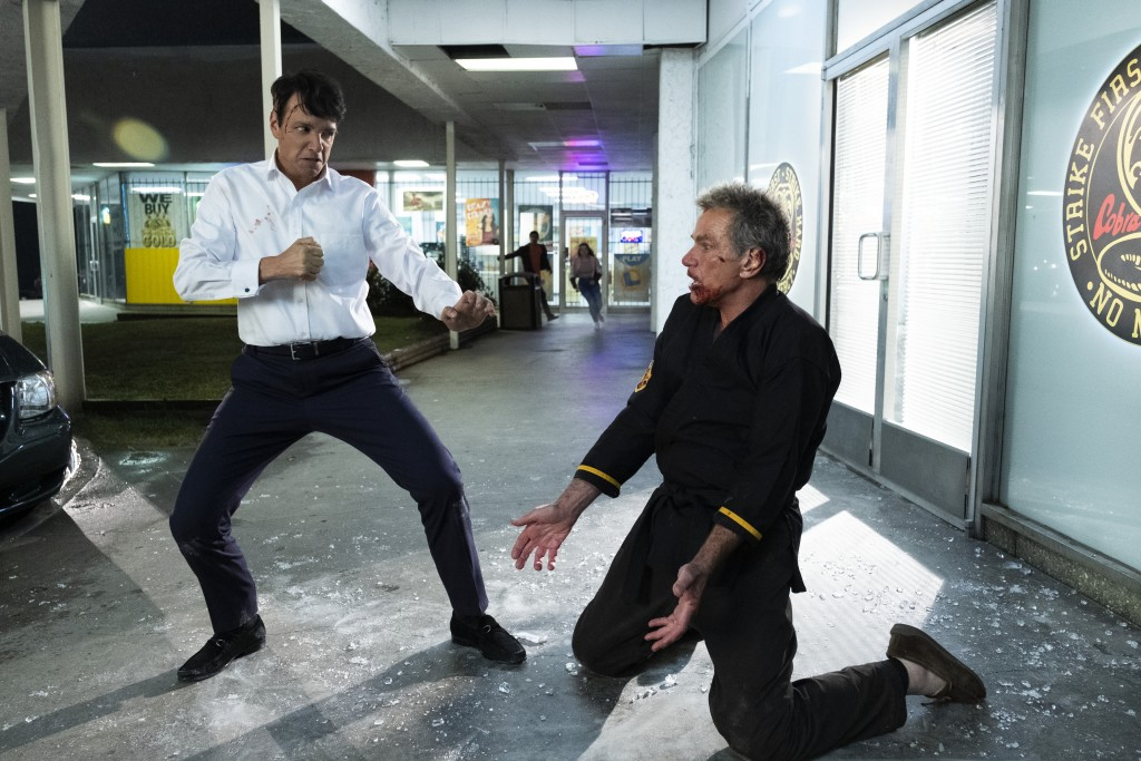 """CORRECTS SPELLING OF RALPH MACCHIO - This image released by Netflix shows Ralph Macchio, left, and Martin Kove in a scene from """"Cobra Kai."""" The progra..."""