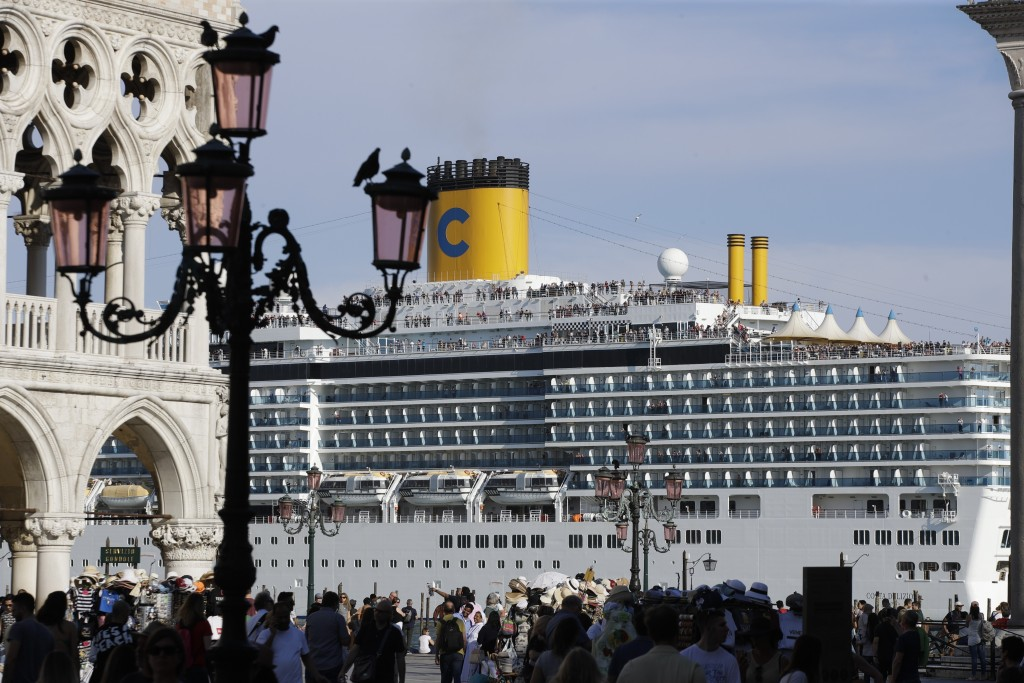 """FILE-- A cruise ship passes by St. Mark's Square filled with tourists, in Venice, Italy, Sunday, June 2, 2019. Declaring Venice's waterways a """"nationa..."""