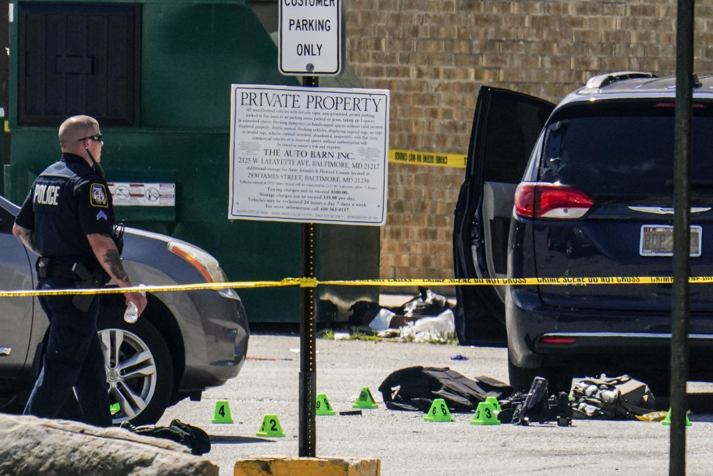 Body armor is seen near a minivan in a parking lot area of a mall where two officers on the U.S. Marshals' task force where allegedly shot in Baltimor...