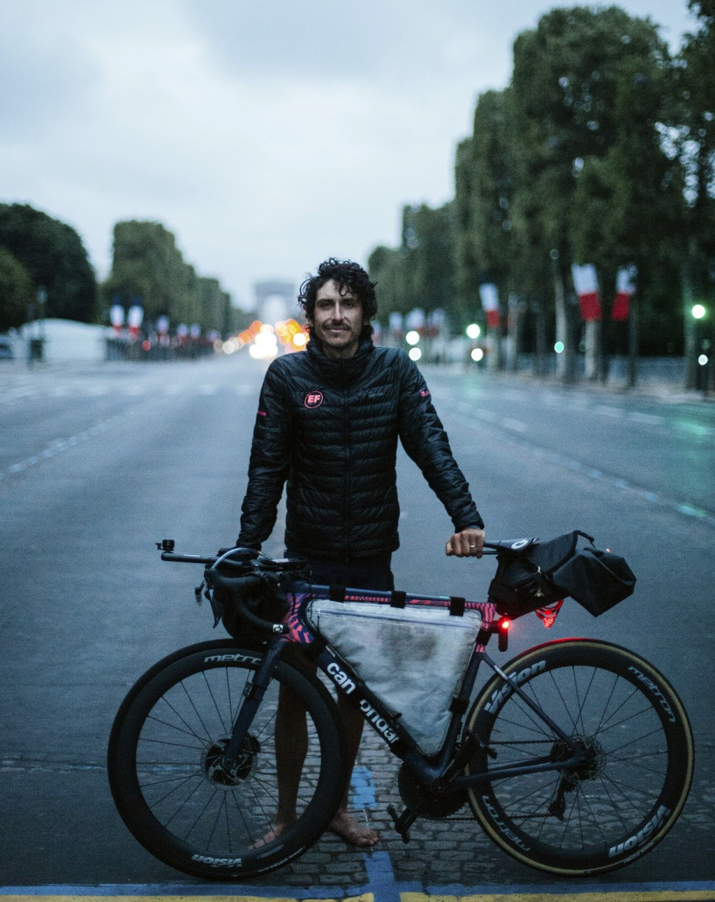 In this image provided by Rapha, cyclist Lachlan Morton poses Tuesday, July 13, 2021, in Paris, France, after completing the cycling route of the Tour...