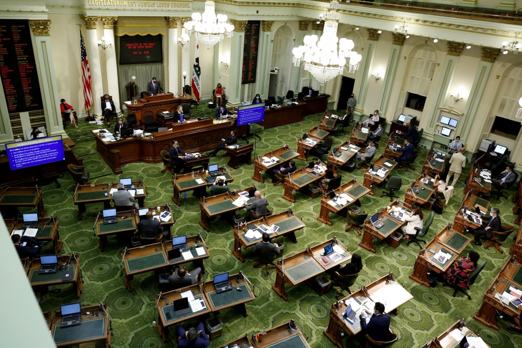 FILE - In this May 26, 2020, file photo, members of the state Assembly meet at the Capitol in Sacramento, Calif. On Thursday, July 15, 2021, Californi...