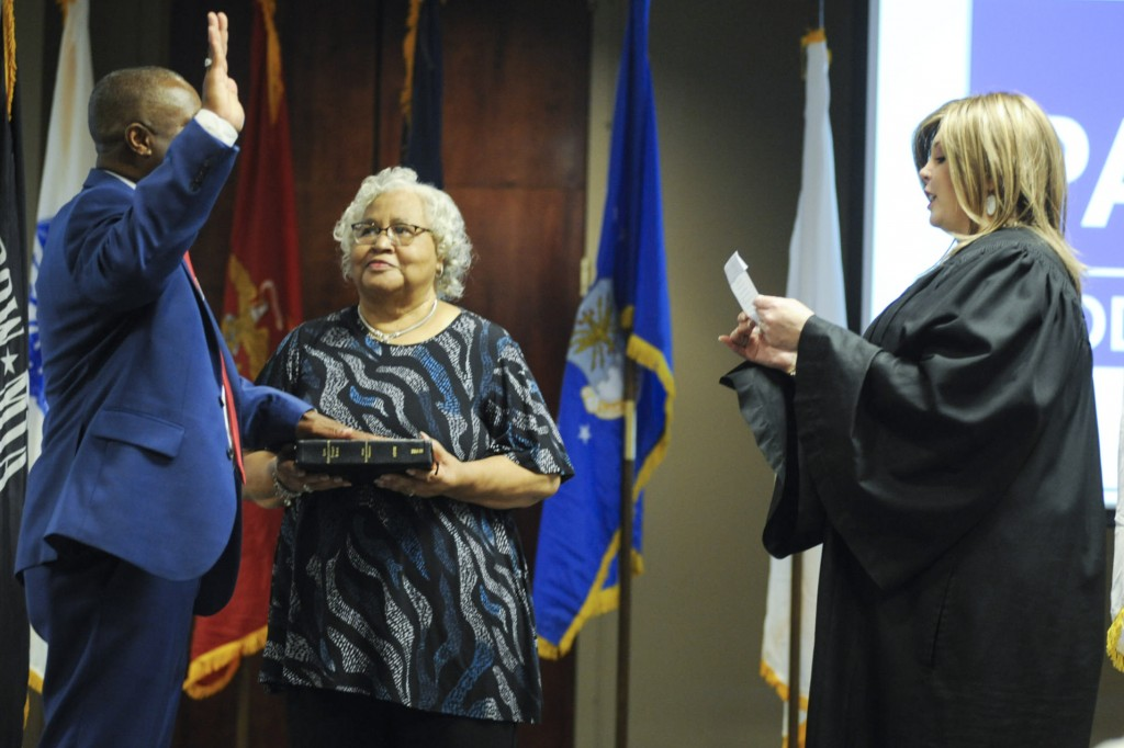 Betty Paschal looks on as her son retired Army Sgt. Kenneth Paschal is sworn in by Judge Lara Alvis as the first Black Republican elected to the Alaba...