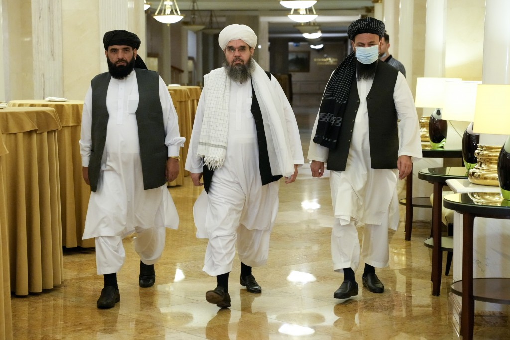 FILE In this file photo taken on Friday, July 9, 2021, Members of political delegation from the Afghan Taliban's movement Suhil Shaheen, left, Mawlawi...