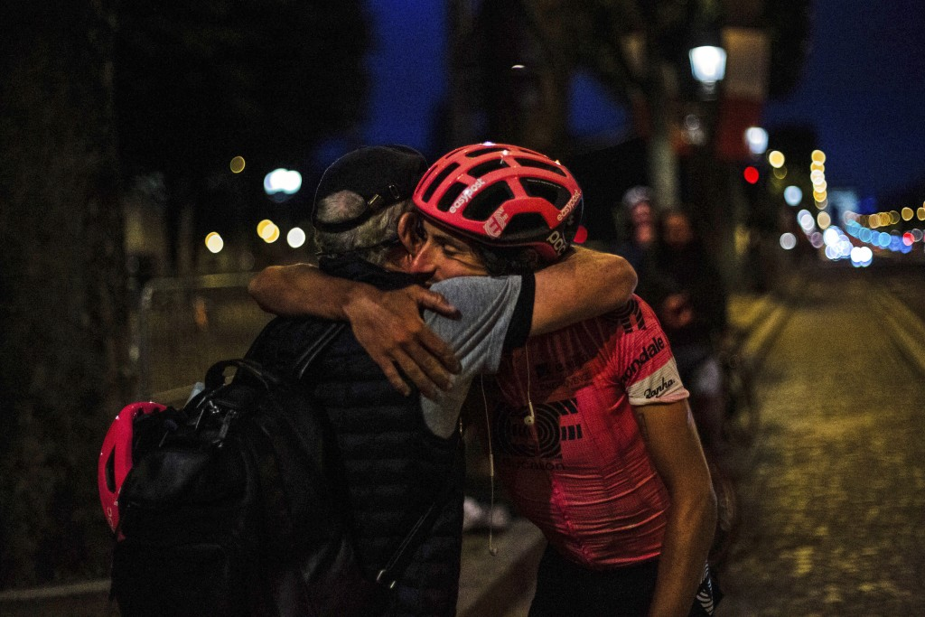 In this image provided by Rapha, cyclist Lachlan Morton is congratulated, Tuesday, July 13, 2021, in Paris, France, after completing the cycling route...