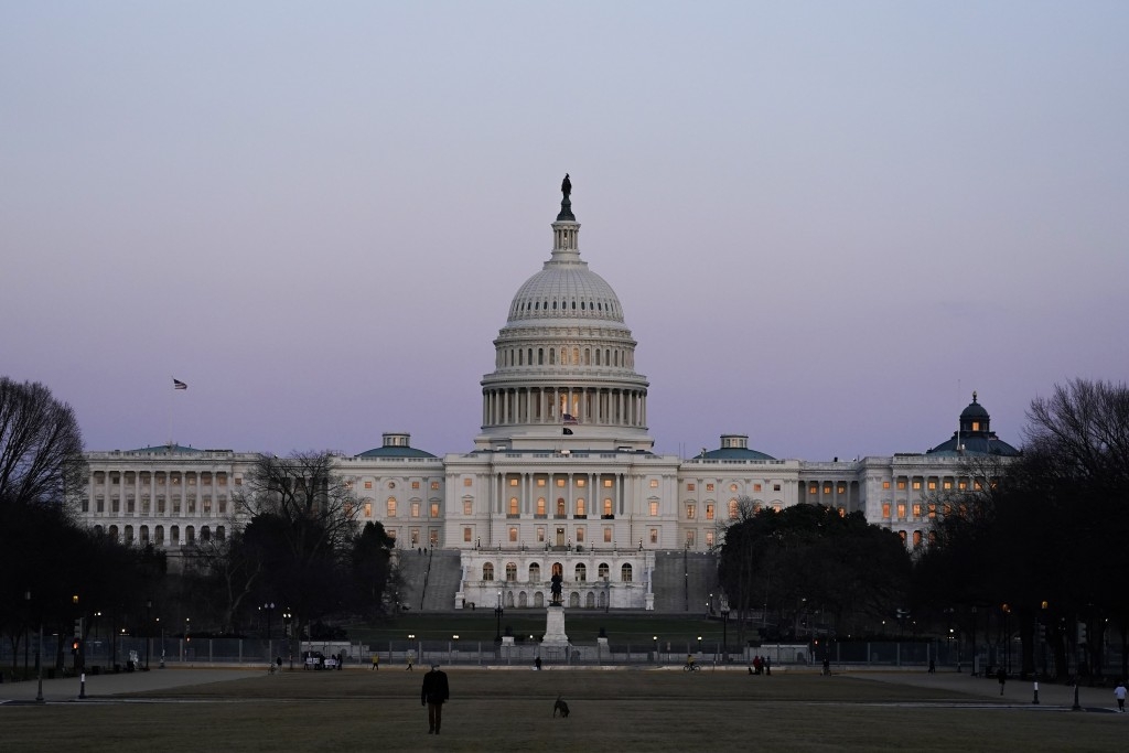 The U.S. Capitol building is shown after sunset Thursday, March 4, 2021, in Washington. The Biden administration is beginning to distribute expanded c...