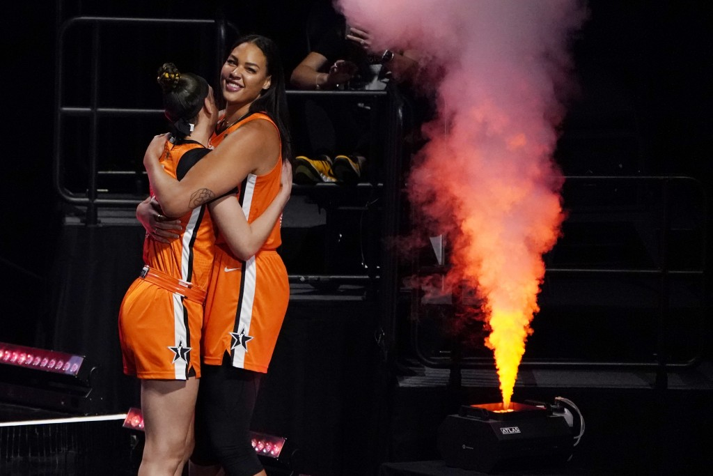 Team WNBA's Dearica Hamby, left, and Liz Cambage embrace before a WNBA All-Star basketball game against the United States, Wednesday, July 14, 2021, i...