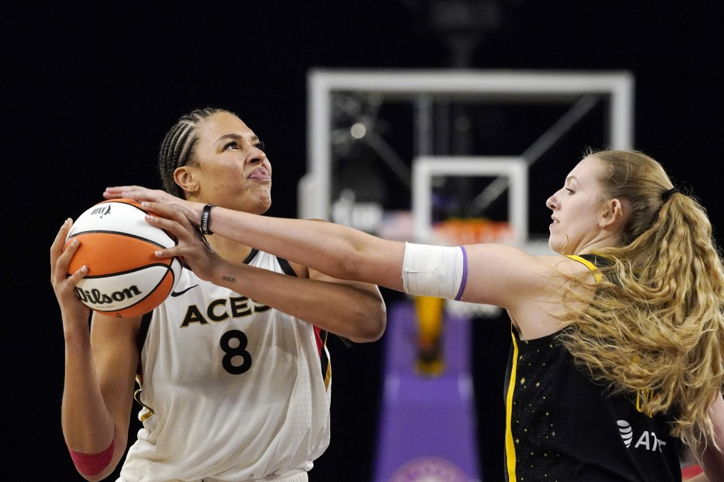 Las Vegas Aces center Liz Cambage, left, tries to shoot as Los Angeles Sparks forward Lauren Cox defends during the second half of a WNBA basketball g...