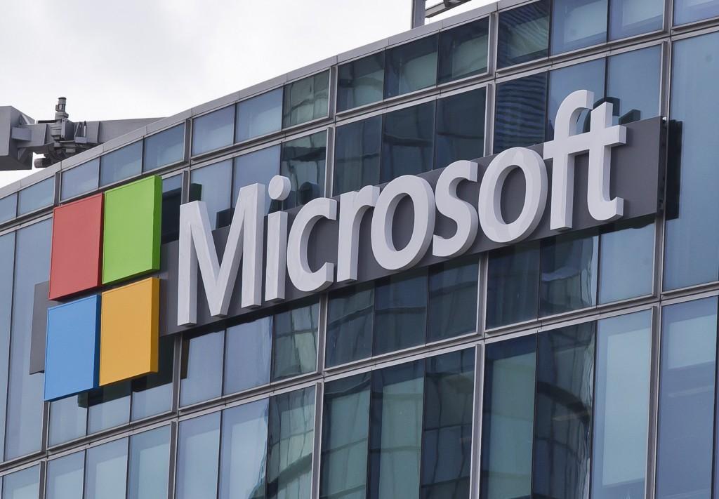 FILE - This April 12, 2016, file photo shows the Microsoft logo in Issy-les-Moulineaux, outside Paris, France. Tech giant Microsoft said Thursday, Jul...