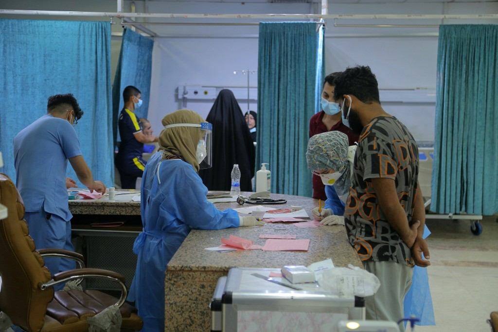 Coronavirus patients wait for treatment at a hospital in Najaf, Iraq, Wednesday, July 14, 2021. Infections in Iraq have surged to record highs amid a ...