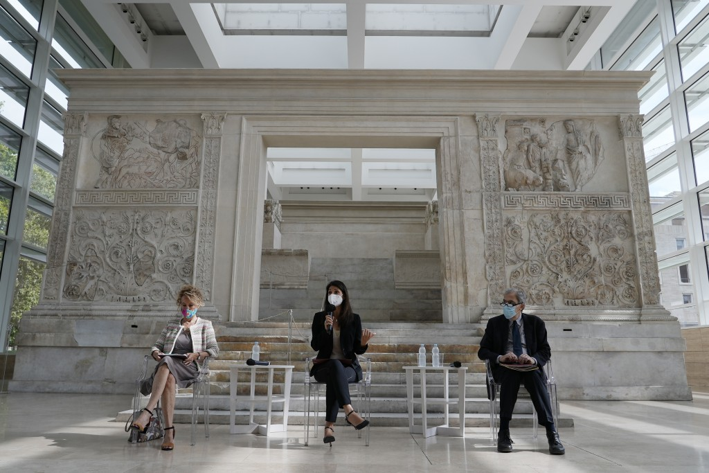 Rome's Mayor Virginia Raggi, center, backdropped by the Ara Pacis (Altar of Peace) presents to journalists an archeological finding emerged during the...