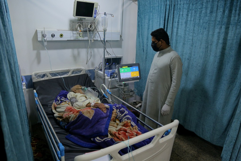 A coronavirus patient receives treatment at a hospital in Najaf, Iraq, Wednesday, July 14, 2021. Infections in Iraq have surged to record highs amid a...