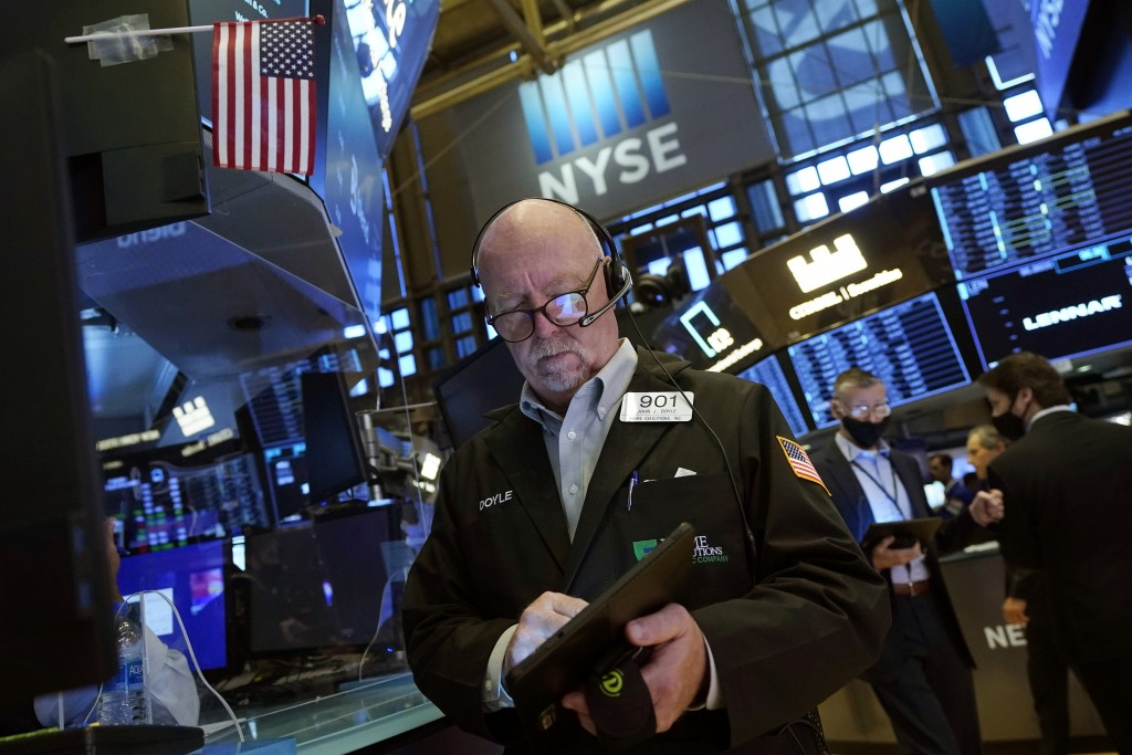 Trader John Doyle works on the floor of the New York Stock Exchange, Friday, July 16, 2021. Stocks are off to a slightly higher start on Wall Street F...
