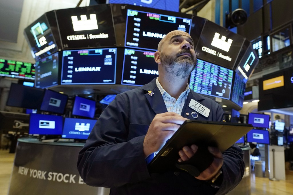 Trader Fred DeMarco works on the floor of the New York Stock Exchange, Friday, July 16, 2021. Stocks are off to a slightly higher start on Wall Street...
