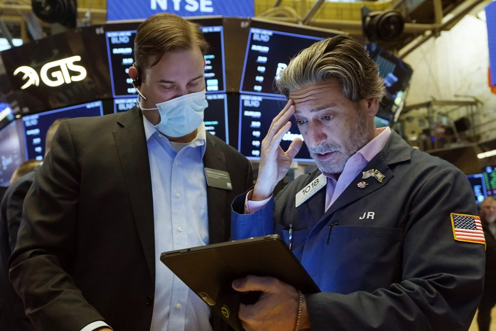 Floor Official Brendan Connolly, left, and trader John Romolo confer on the floor of the New York Stock Exchange.