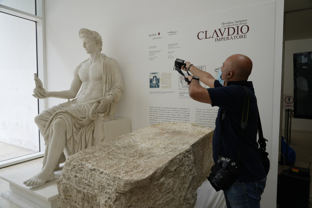 A photographer takes pictures during the presentation to the press of an archeological finding emerged during the excavations at a Mausoleum in Rome, ...