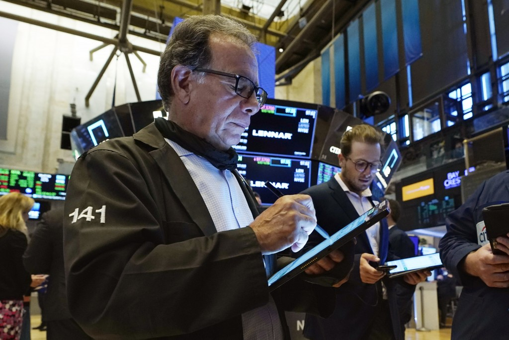 Traders Sal Suarino, left, and Ben Tuchman work on the floor of the New York Stock Exchange, Friday, July 16, 2021. Stocks are off to a slightly highe...