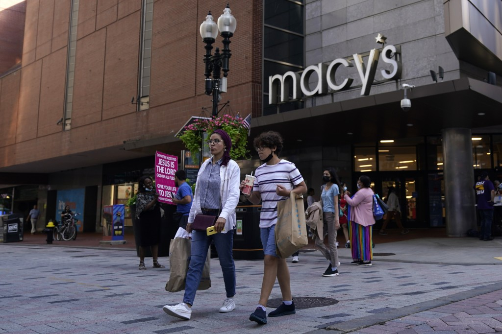 Pedestrians pass the Macy's store in the Downtown Crossing shopping area, Wednesday, July 14, 2021, in Boston.  . U.S. retail sales rose a seasonal ad...