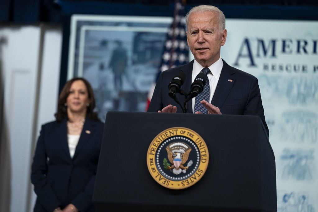 Vice President Kamala Harris listens as President Joe Biden speaks during an event to mark the start of monthly Child Tax Credit relief payments, in t...