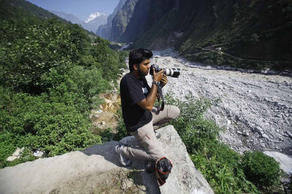 Reuters photographer Danish Siddiqui covers the monsoon floods and landslides in the upper reaches of Govindghat, India, Saturday, June 22, 2013. Afgh...