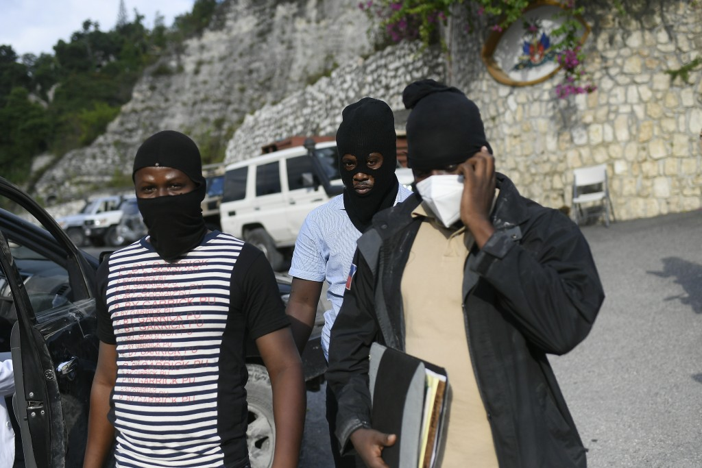 Police officers investigating the assassination of President Jovenel Moise leave his residence in Port-au-Prince, Haiti, Thursday, July 15, 2021. Pres...