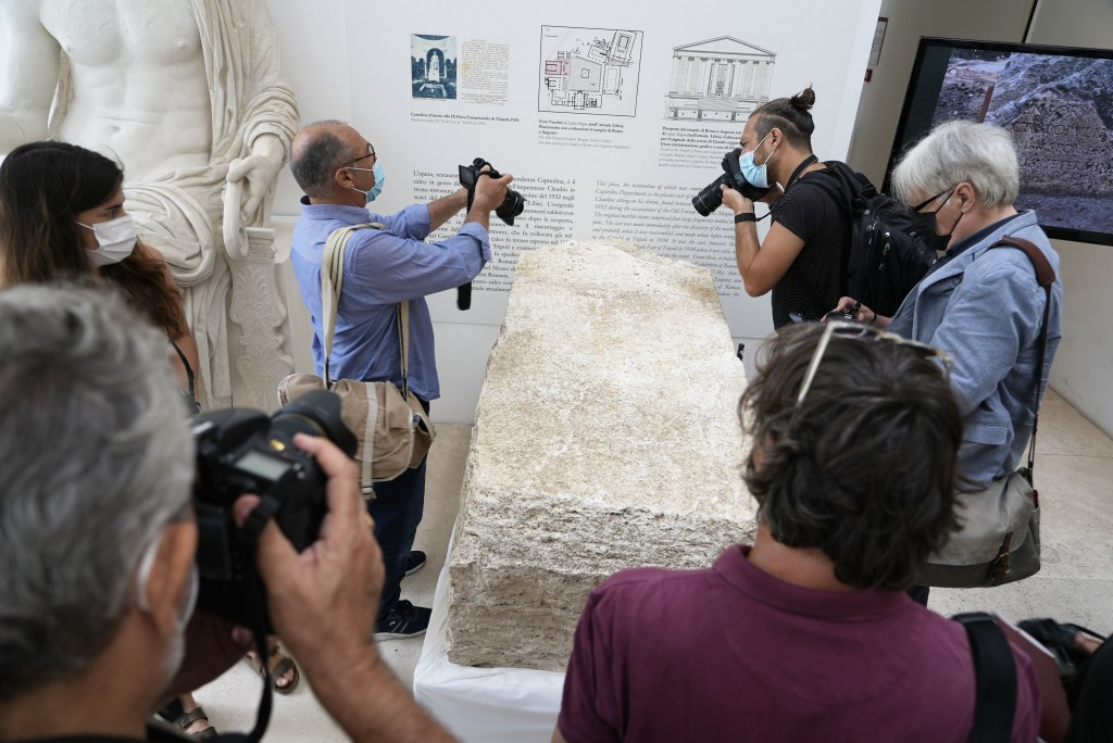 Photographers take pictures during the presentation to the press of an archeological finding emerged during the excavations at a Mausoleum in Rome, Fr...
