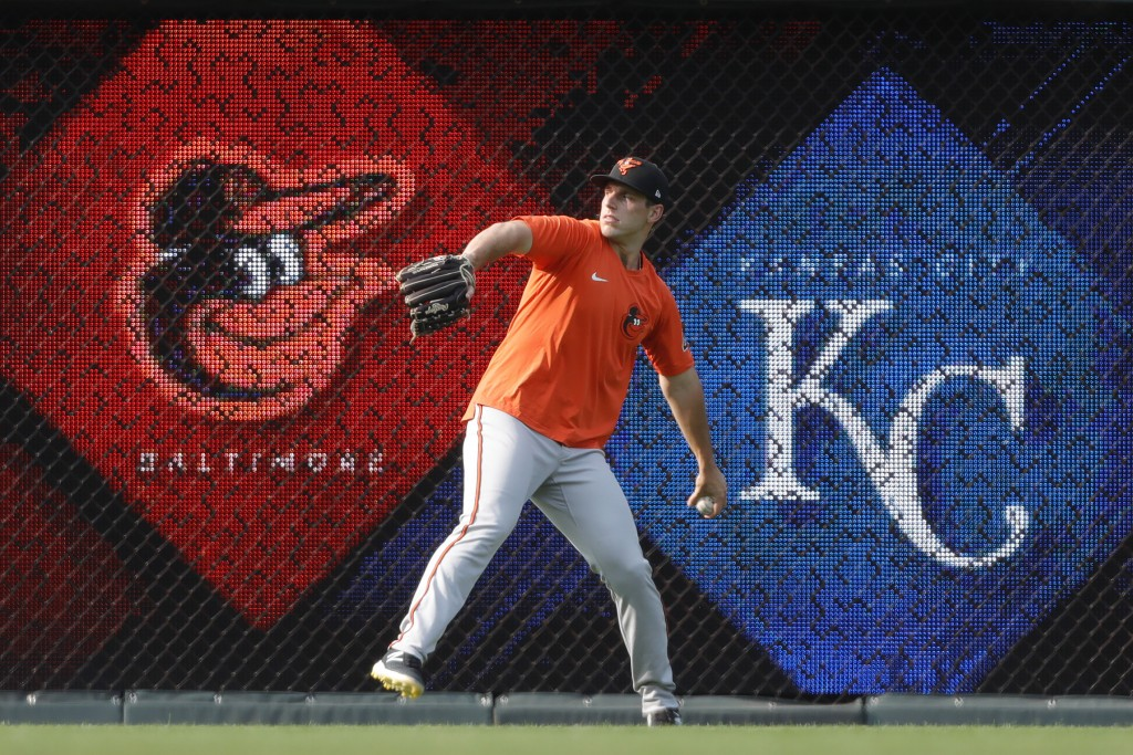 CORRECTS TO JOHN MEANS NOT KEEGAN AKIN - Baltimore Orioles pitcher John Means warms up in the outfield before a baseball game against the Kansas City ...