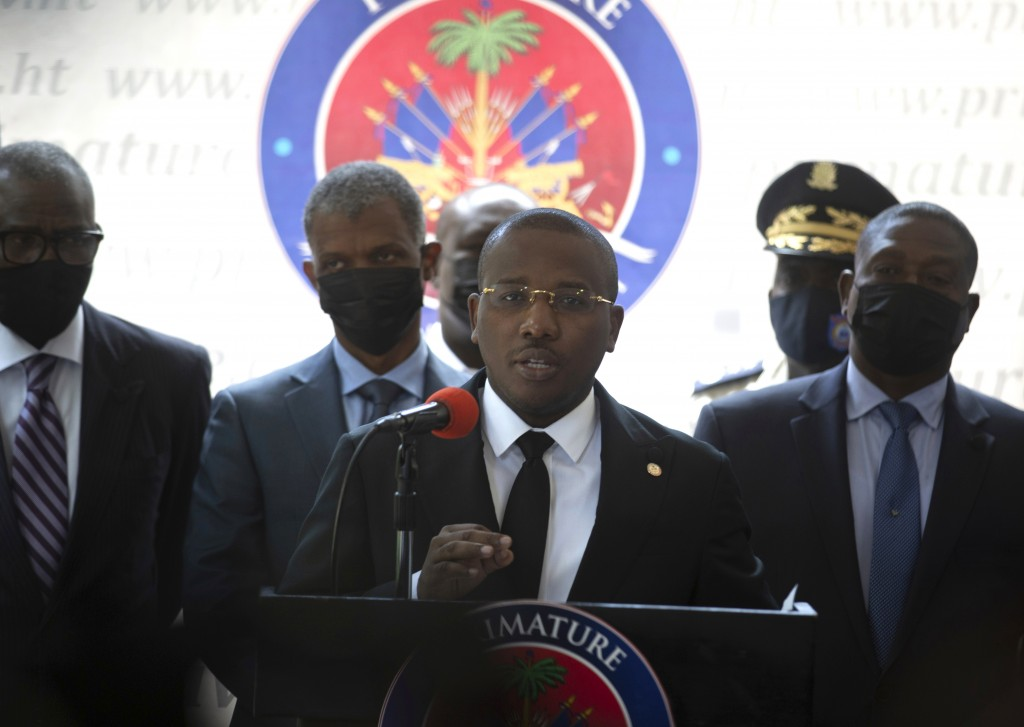 Haiti's interim Prime Minister Claude Joseph gives a press conference in Port-au-Prince, Friday, July 16, 2021, the week after the assassination of Ha...