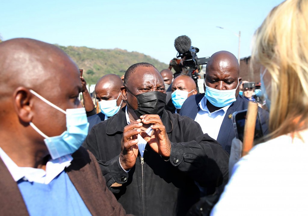 South African President Cyril Ramaphosa, visits an area in Durban, South Africa, Friday, July 16, 2021 which was badly affected by unrest in the past ...
