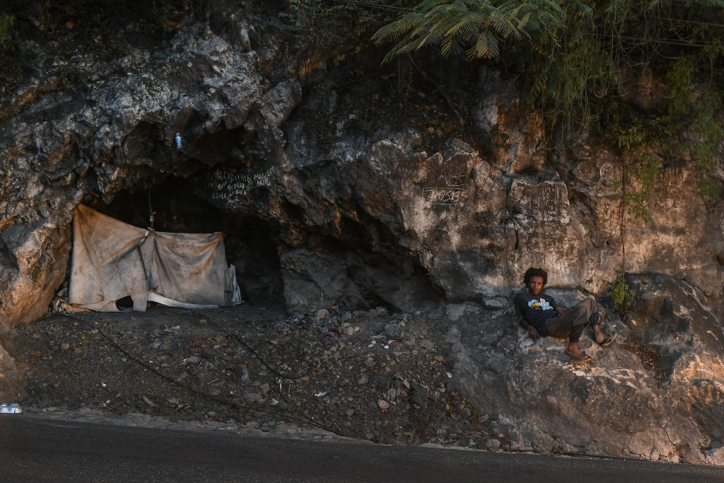 A person lies next to their tent along a street in Port-au-Prince, Haiti, Saturday, July 17, 2021. The country of more than 11 million people are stil...