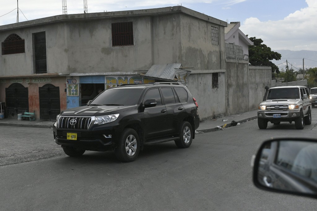 Haiti's first lady Martine Moise is escorted in a caravan of vehicles after returning to Port-au-Prince, Haiti, Saturday, July 17, 2021, ten days afte...