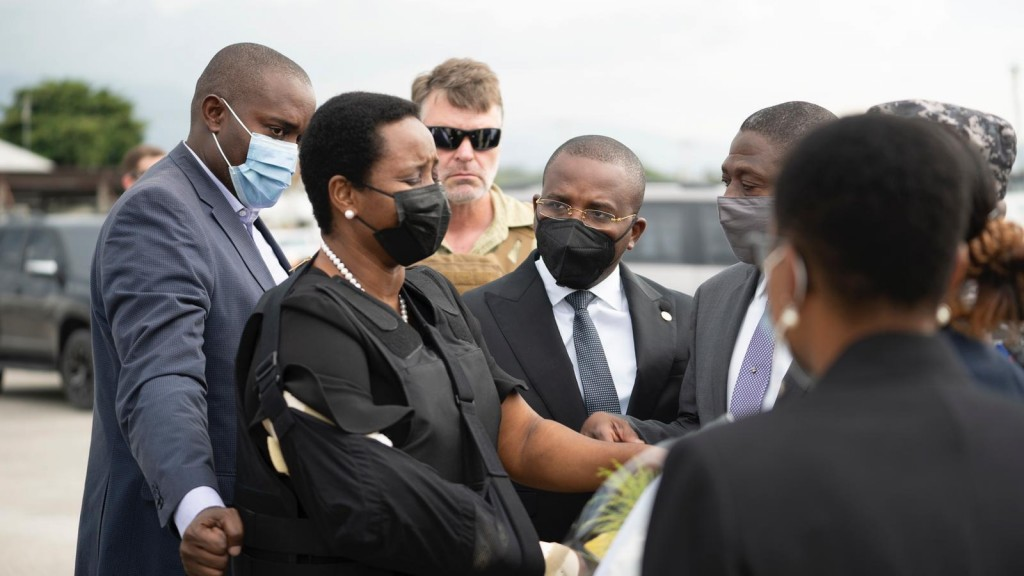 In this handout photo released by Haiti's Secretary of State for Communication, Haiti's first lady Martine Moise, wearing a bullet proof vest and her ...