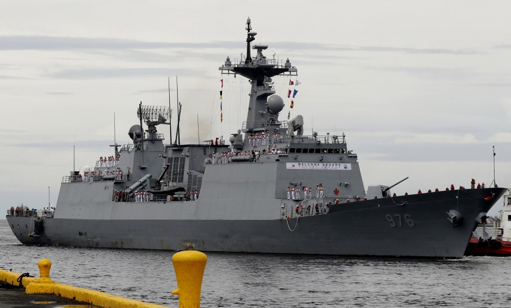 FILE - In this Sept. 2, 2019, file photo, South Korean navy destroyer, the Munmu The Great, prepares to dock at the Manila South Harbor for a three-da...