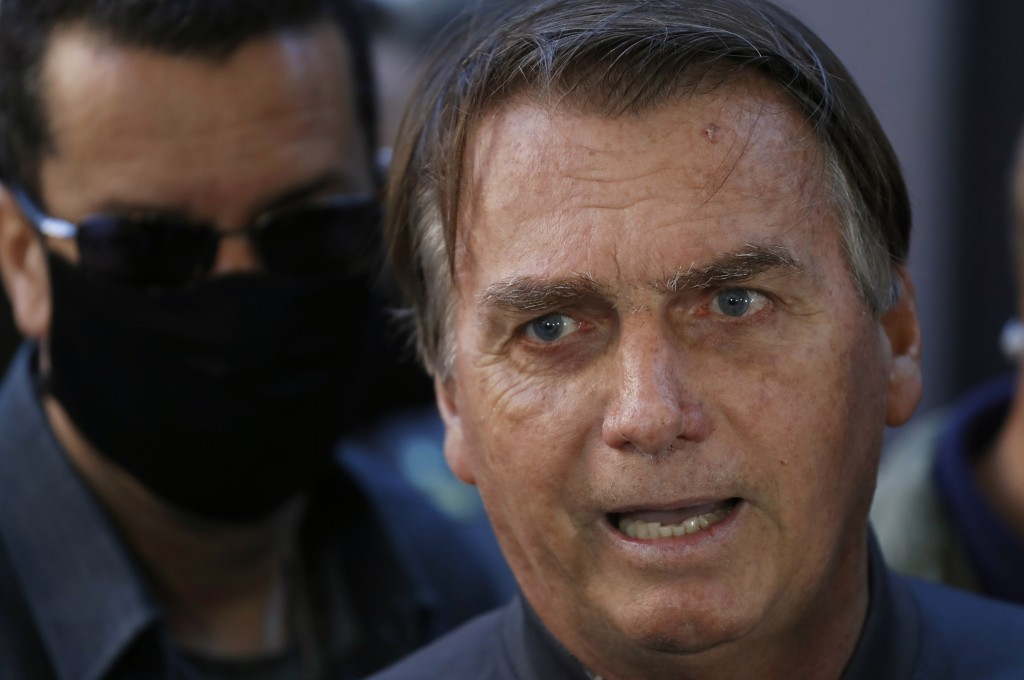 Brazil's President Jair Bolsonaro speaks to reporters as he leaves the hospital after recovering from an intestinal obstruction in Sao Paulo, Brazil, ...