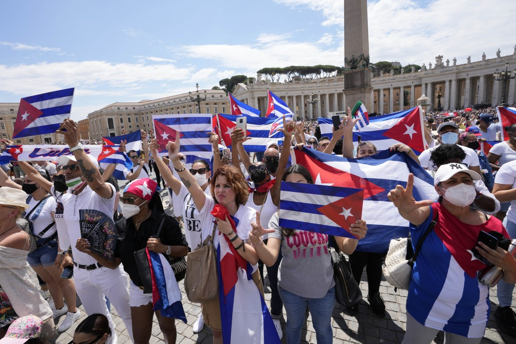 Members of Italian Cuban community show flags during Pope Francis' Angelus noon prayer from the window of his studio overlooking St.Peter's Square, at...