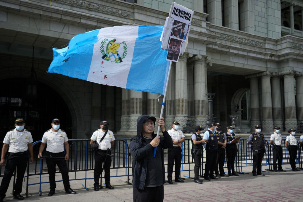 A protestor waves a national flag during a rally demanding the resignation of Guatemalan President Alejandro Giammattei, claiming his government has m...