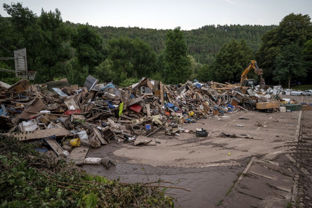 Furniture damaged by the flood piles up at a collection point, in Kordel, Germany, from where it is transported on again Saturday, July 17, 2021. Nume...