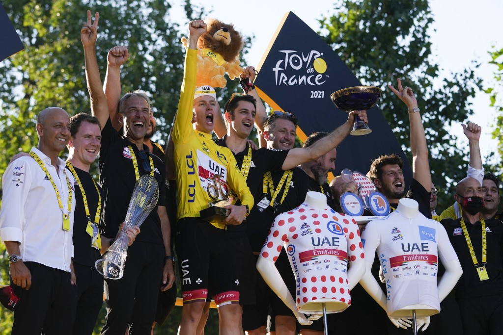 Tour de France winner Slovenia's Tadej Pogacar, who won the overall leader's yellow jersey, the best climber's dotted jersey, and the best young rider...