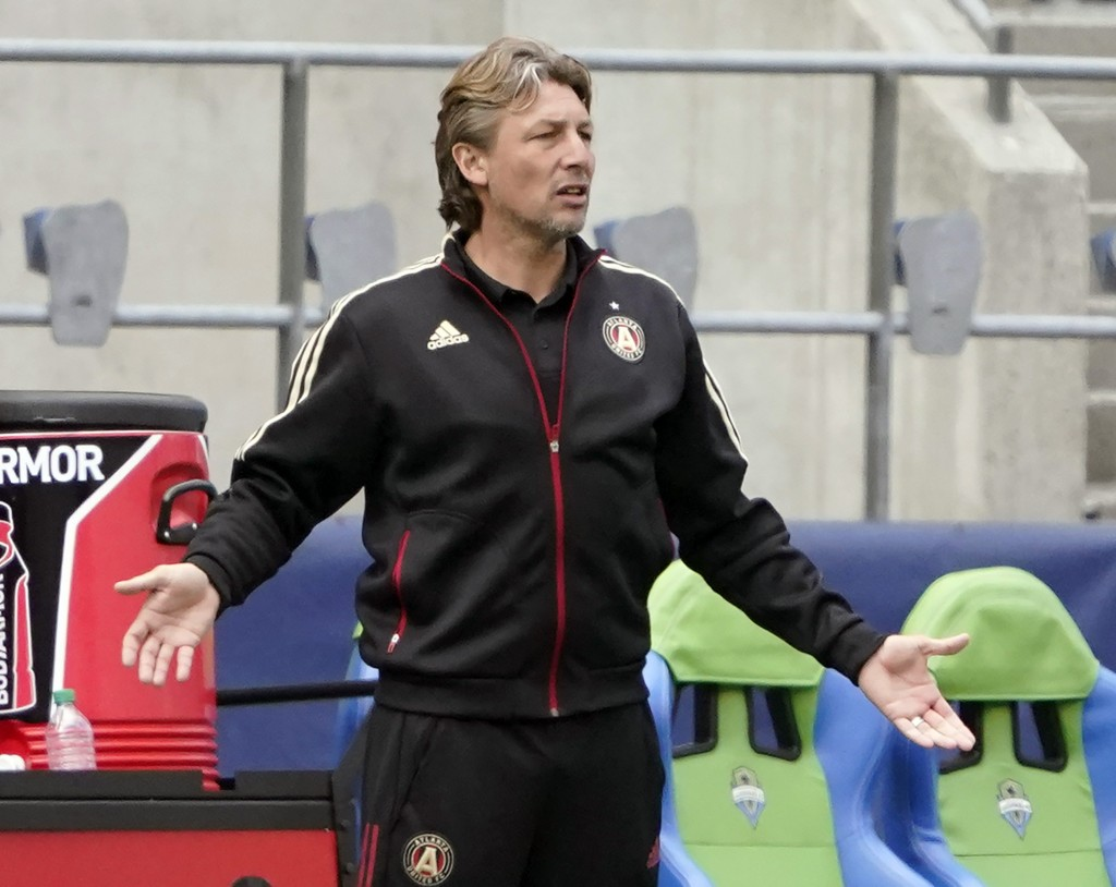 FILE - In this May 23, 2021, file photo, Atlanta United head coach Gabriel Heinze gestures from the bench during the second half of an MLS soccer matc...