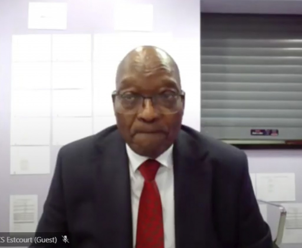 In this Frame grab former South Africa President Jacob Zuma, appears on a screen virtually from the correctional service facility Estcourt, in Pieterm...
