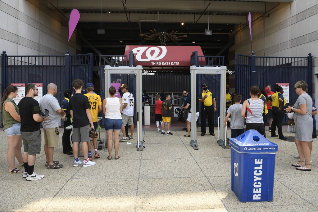 Spectators enter through the third base gate before the continuation of a suspended baseball game between the Washington Nationals and the San Diego P...