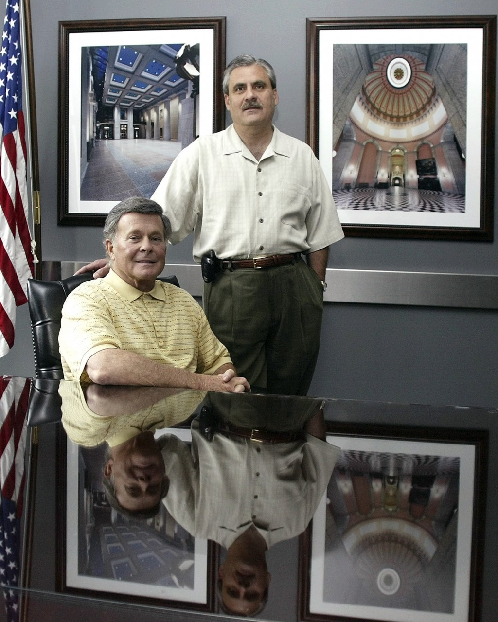 FILE - In this May 27, 2004, file photo, Paul Tipps, left, and Neil Clark pose in their office in Columbus, Ohio. Clark, a longtime Ohio lobbyist, who...