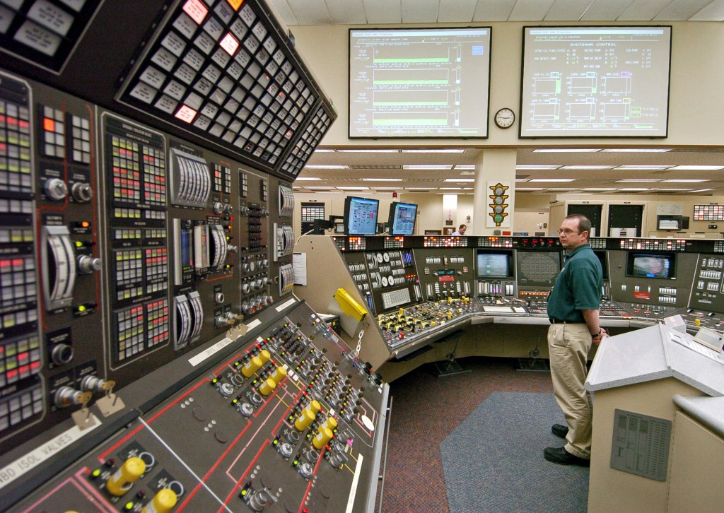 FILE – In this April 12, 2005, file photo, operator Kevin Holko monitors the control room during a scheduled refueling shutdown at the Perry Nuclear P...