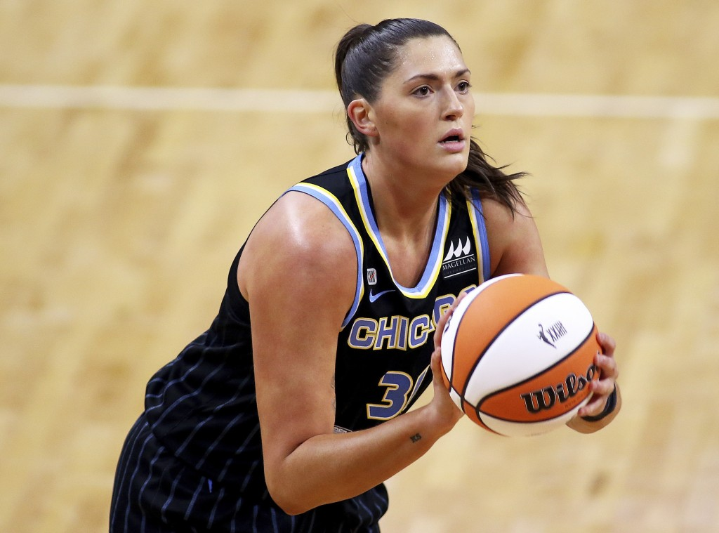 FILE - In this May 15, 2021, file photo, Chicago Sky center Stefanie Dolson controls the ball during a WNBA basketball game against the Connecticut My...