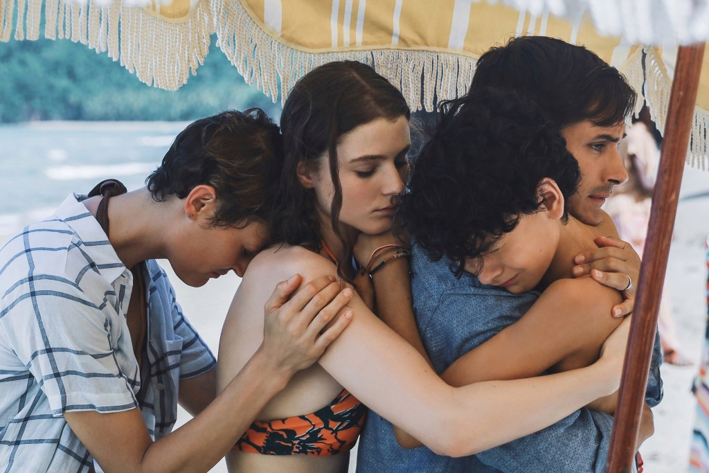 This image released by Universal Pictures shows, from left, Vicky Krieps, Thomasin McKenzie, Gael García Bernal and Luca Faustino Rodriguez in a scene...