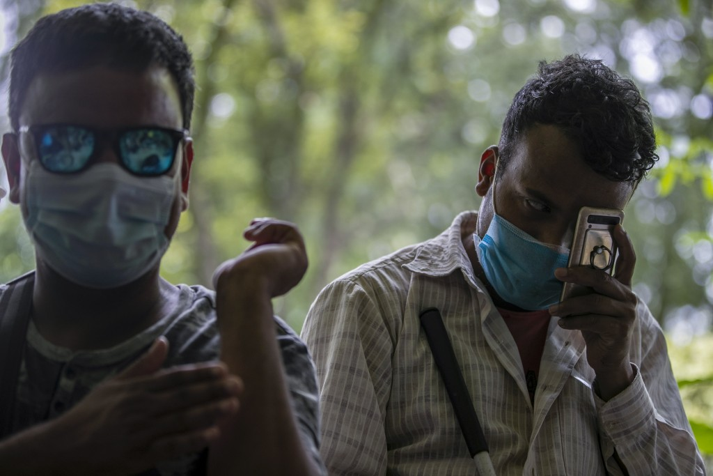 Nepalese men who are blind wait to receive Johnson and Johnson vaccine at the Nepal Disabled Association Khagendra New Life Center in Kathmandu, Nepal...